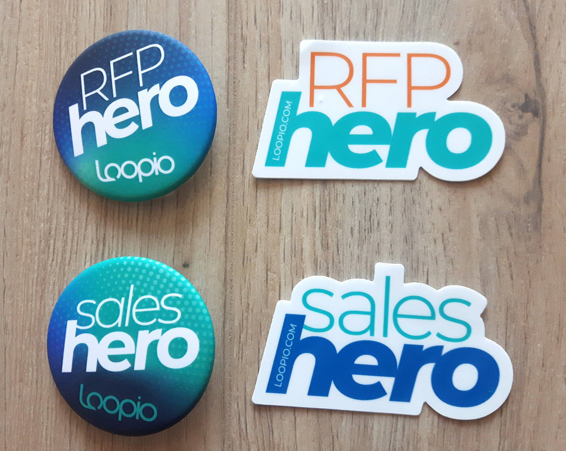 Two pins and two stickers for RFP and Sales Heroes