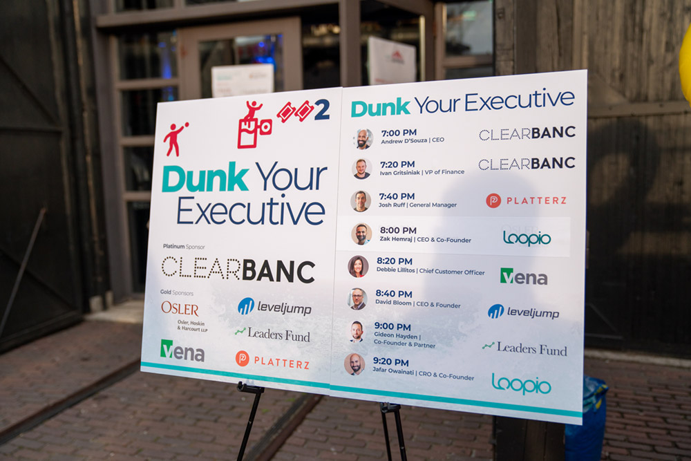 Signage for the executive dunktank with schedule and executive headshots